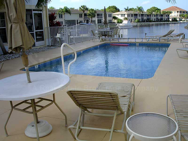 Coral Del Rio Community Pool and Sun Deck Furnishings